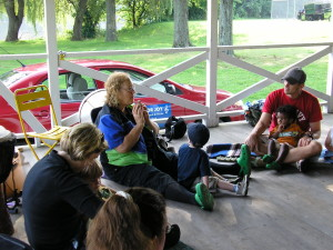 Children and parents listen to the sweet tone of the ocarina, a Peruvian clay flute.