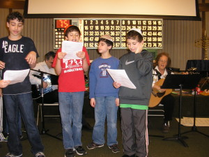 Hebrew school fifthe graders lead their classmates in song.
