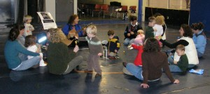 Children and parents gather for a morning greeting song.
